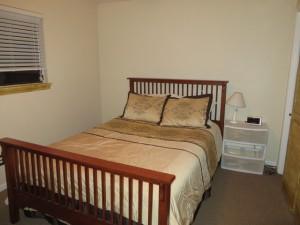 Ellen guest bedroom bed after